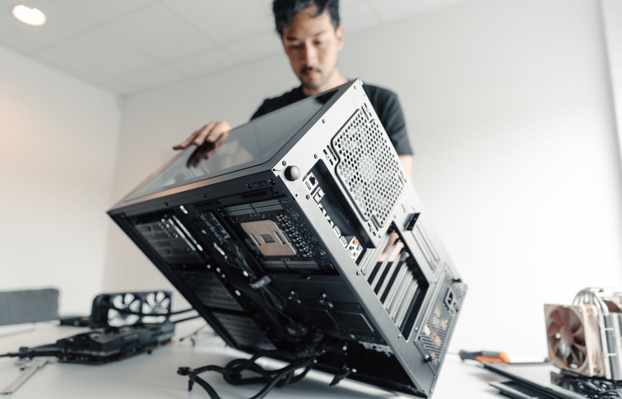 Image of Fractal Design Employee and a computer